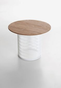 END TABLE IDEA: metal garbage bin + wood top ( possibly with built in lighting underneath or just a nice lamp on top