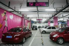 A Chinese car park, designed exclusively for lady drivers has been constructed at the underground shopping centre car park in Tianjin. The parking spaces have extra wide bays and hazard bumpers in each space which is a good thing considering the bad reputation that woman drivers have worldwide.    Walls are painted pink, while floral decorations dot the area. Each bay is clearly marked in bright neon signs, and bright pink shopping themed décor is installed