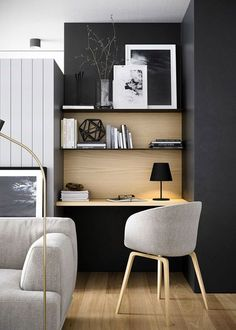 Stylish grey-toned home office with wooden details.