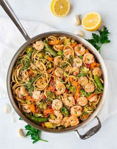 Lemon Garlic Shrimp Pasta. This delicious dinner takes only 30 minutes to prepare! Fresh tasting with lemon and garlic, but loaded with frozen veggies and shrimp to make prep easy.
