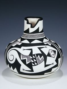 Acoma Pueblo Hand Coiled Pottery by Westly Begaye. Westly was born into the Navajo Nation in 1965. He was taught by his long time companion, Marie Francis Vallo, an Acoma potter who is the mother of Leland, Kim and Thomas Vallo. Westly's work is a fusing of Navajo and Acoma traditions. He has developed his own unique style, giving his pots an amazing contemporary flare.