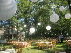 This back yard wedding featured over 60 paper lanterns (these are called uneven ribbed or Modern Asian Lanterns).  A Very Special Day drove out to Sulpher Springs Tx a day early to make sure all the lighting looked perfect the night before this wedding reception.  Richard McClure, DJ'd the event by putting speakers throughout the back yard.  Special LED Lighting Towers were placed through out the parking area so guests could see their way to their cars. - A Very Special Day - www.avsday.com