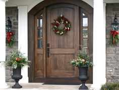 Love the arched door - would look great behind the arch of the front porch