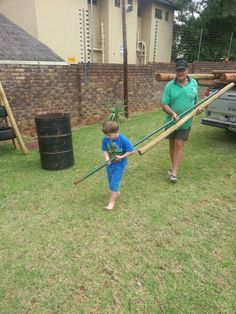 23 March 2015 - Franco helping to move the jungle gym to our new school.