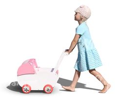 A blond barefoot girl playing with a baby carriage
