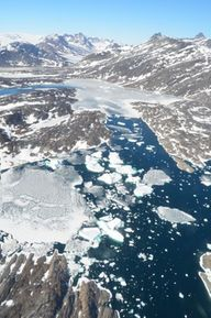Fiord choked with melting sea ice and icebergs in East Greenland, during the month of June.