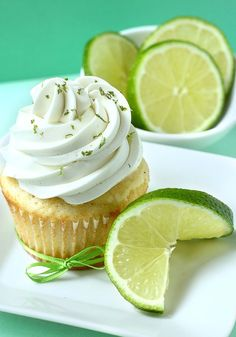 Lime Cupcakes - vanilla cupcakes with lime curd and Swiss meringue buttercream....