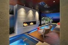 Beautiful Beach House in California: Incredible The Strand Residence Home Design In Outdoor Space Decorated With Modern Indoor And Outdoor Pool Design Completed With Modern Fireplace Design ~ SFXit Design Architecture Inspiration Architecture Design, Landscape Architecture, Piscina Interior, Moderne Pools, Deco Design, Design Design, Modern Design, Fireplace Design, Fireplace Mantels
