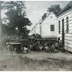 A large group of Afrikan American captives living outside of their slave quarters in Charleston South Carolina c. 1860. One of the few series of pictures to document slavery in America.