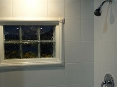 An acrylic window trim kit is being used on the inside of these acrylic shower wall panels to finish it off. Learn more about trimming shower windows in this article. | Innovate Building Solutions