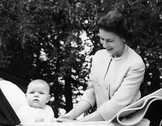Prince Andrew sits up in his carriage as his mother, Queen Elizabeth II, smiles down at him, when the baby prince was nearing his seventh-month birthday on Sept. 13, 1960.