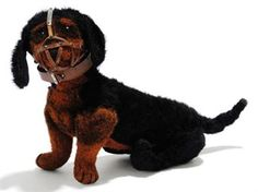 A STEIFF JOINTED BURLAP DACHSHUND, (5217), black and brown, black boot button eyes, black stitching, swivel head, inoperative squeaker, leather collar stamped STEIFF, leather muzzle and FF button, circa 1909 --11in. (28cm.) long