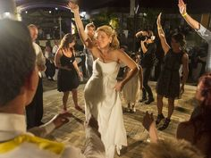 Shelly Osterhout, center, dances at her wedding reception