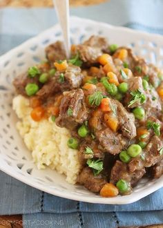 Irish Beef Stew with Mashed Potatoes http://www.thecomfortofcooking.com/2014/03/irish-beef-stew-with-mashed-potatoes.html
