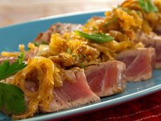 Grilled Tuna with Caramelized Onions, Cinnamon and Mint Recipe : Bobby Flay : Food Network Tuna Steak Recipes, Grilled Shrimp Recipes, Grilled Seafood, Seafood Recipes, Crispy Onions, Caramelized Onions, Grilled Tuna Steaks, Grilled Salmon, Grilled Eggplant