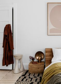White bedroom with pops of warm brown, blush, and mustard