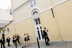 ... and they're on their way in!! Laura & Bennett's big day was just perfect! Tate Tullier Photography. Latrobe's On Royal. French Quarter, New Orleans Wedding.