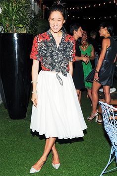 Newly appointed Editor in Chief of Lucky Magazine Eva Chen proved to be a fashionable party guest as she helped celebrate the launch of Rebecca Minkoff's denim line at the Mondrian SoHo in New York on June 25th. Under the stars on the rooftop terrace, Chen matched a white midi-skirt with a Tahitian printed crop-top hitting on the black, white, and red trend of the season.