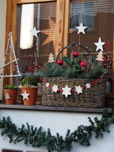 Outdoor Christmas decoration for window garland and stars - Christmas Decoration - [post_tags Christmas Window Boxes, Christmas Planters, Christmas Porch, Outdoor Christmas Decorations, Winter Christmas, All Things Christmas, Rustic Christmas, Christmas Wreaths, Christmas Crafts
