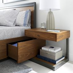 Shop Blair King Storage Bed. A metal plinth gives the king-sized storage bed a lift, adding height and a floating appearance that marks it modern. Designed by Bill Eastburn of William Eastburn Design, the Blair King Bed is a Crate and Barrel exclusive.