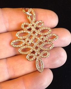 Rose Gold Knot Pendant Sterling Silver with 18k rose gold plating.  Syn. Zircon Stones