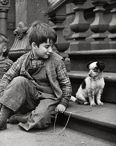 :::::::::: Vintage Photograph :::::::::: How I love this image of a boy and his beloved scraggly, lovable, puppy. Photographer Clemens Kalischer.