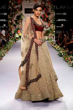 Looking for marsala blouse and gold lehenga with all over embellishment? Browse of latest bridal photos, lehenga & jewelry designs, decor ideas, etc. Indian Bridal Wear, Indian Wedding Outfits, Pakistani Bridal, Bridal Lehenga, Indian Outfits, Eid Outfits, Gold Lehenga, Anarkali Lehenga, Patiala Salwar