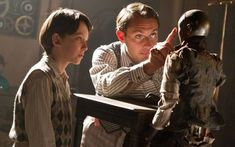 Asa Butterfield and Jude Law in Hugo, directed by Martin Scorcese Hugo Movie, Movie Tv, Martin Scorsese, Best Kids Films, Books Turned Into Movies, Hugo Cabret, 2011 Movies, Asa Butterfield, Around The World In 80 Days
