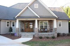 The exterior walls Sherwin Williams Duration Satin Intellectual Gray The darker Siding at Gables is S/W duration 7046 Anonymous​. Exterior trim is S/W Duration gloss- custom mixed formula. House Siding, House Paint Exterior, Exterior Siding, Exterior Remodel, Exterior Paint Colors, Exterior House Colors, Siding Colors For Houses, Gray House Exteriors, Stone On House Exterior