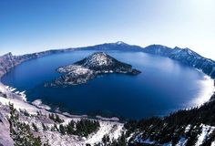Crater Lake National Park, Oregon. 183,224.05 acres.  Lies in the caldera of Mount Mazama formed 7,700 years ago after an eruption.  It is the deepest lake in the USA and is known for its blue color and water clarity.  There are two islands on the lake and with no inlets or outlets, all water comes from precipitation.