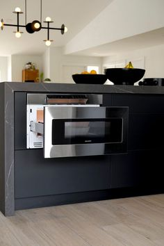 Me & Mr. Jones home decor blog. Modern black kitchen remodel with sharp drawer microwave in island. Sharp Microwave Drawer, Microwave In Island, Black Kitchens, Home Kitchens, Waterfall Island, Black And White Interior, Stylish Kitchen, Affordable Home Decor, Decorating Blogs