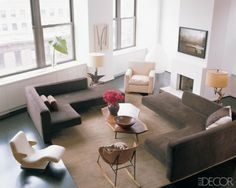 Lofty Ideal    Actress Julianne Moore's West Village loft is modern comfort at its best. A neutral palette of brown and cream gives the star's home a calm, no-frills vibe. Vintage L-shaped sofas by Vladimir Kagan and a leather armchair from Furniture Co. provide ample seating, while driftwood table lamps add a rustic touch. The light-filled space also has killer views of the Hudson River.    Photographer: Pieter Estersohn
