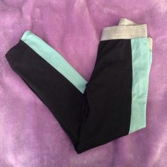 Black and turquoise workout leggings-cropped Above the ankle workout leggings with turquoise stripes on sides. Tight . Perfect condition, worn once Forever 21 Pants Leggings