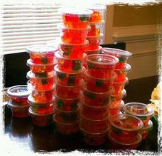 Drunken Gummies -- Walmart brand gummy bears soaked in Bacardi Watermelon for 3 days (stirring 2x a day) packaged up in small disposable containers. Party success!