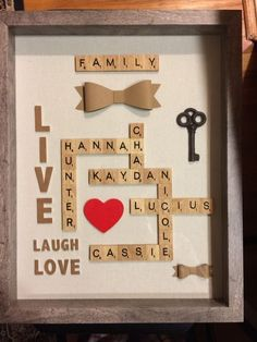 Scrabble tiles with family names scrabble pieces crafts, scrabble letter crafts, scrabble wall art Scrabble Kunst, Scrabble Tile Art, Scrabble Frame, Scrabble Family Names, Marriage Anniversary, Wedding Anniversary Gifts, Anniversary Ideas, Anniversary Scrapbook, Second Anniversary