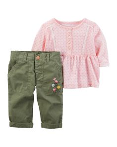 Crawling, playing or sleeping, she's cute and comfy in this 2-piece set! Complete with a lace top and embroidered pants.