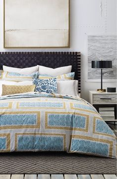 A modern geometric-inspired pattern in rich, eye-catching colors styles this cotton duvet cover, providing a striking centerpiece for the bedroom décor.