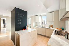 If there are columns or dividers into the kitchen, take advantage of that