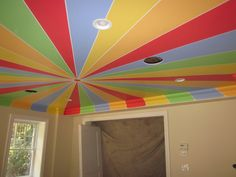 Do something like this in the girls' room using the different ceiling angles as guidelines?  Definitely need a bright, contrasting color on their ceiling if not something silly and fun like this.