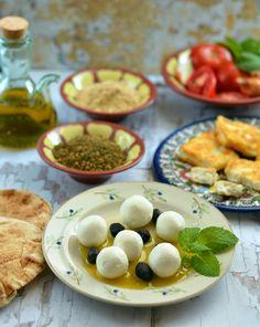 labneh, pickled tomatoes, dukkah ,spring onions, arugula, green, black olives, feteer,mesh , honey, molasses , foul & falafel (easter breakfast)