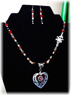"red Czech faceted rondelles, silver plated and antiqued chain and findings with silver plated barrel spacers. The ""skull"" has a flower on it's head and heart shaped ""eye holes"". Eye Hole, Jewelry Sets, Jewelry Making, Head And Heart, Heart Shapes, Handmade Jewelry, Skull, Angel, Graphics"