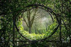 Green moon gate, window in a hedge, Orsan. Image by Francois Berraldacci. www.berraldacci.fr