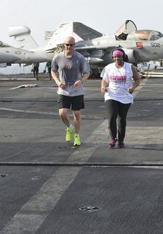 GULF OF OMAN (June 23, 2013) – Cmdr. John Cummings, left, executive officer of the aircraft carrier USS Nimitz (CVN 68), runs with Aviation Ordnanceman 1st Class Jasmin Shackelford during a 5-kilometer run on the flight deck. Nimitz Strike Group is deployed to the U.S. 5th Fleet area of responsibility conducting maritime security operations, theater security cooperation efforts and support missions for Operation Enduring Freedom.