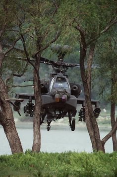 AH-64D Apache hiding behind trees.  Yes, you can see it (else the picture would use lame), but the low altitude and trees make it much more difficult for some radar systems to locate.