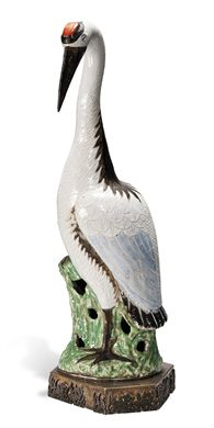 A PORCELAIN MODEL OF A CRANE