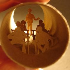 Beautiful miniature paper arts.  With a quirky canvas and steady hand, Anastassia Elias creates fantastic scenes inside empty toilet paper rolls. With the right lighting these scenes burst to life; silhouettes in a land of cardboard. Toilet Paper Roll Art, Toilet Art, Brown Paper Roll, Tiny World, Sculpture, Illustrations, Creative Crafts, Cool Artwork, Paper Crafting