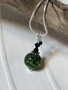 Delicate Green Glass Necklace with black decorations and crystals