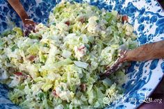 MEN LOVE IT SALAD   1 head lettuce, bite size pieces 1 medium onion, diced fine 1 head cauliflower, chopped fine 1 lb. bacon, crisp and crumbled 1/2 Cup grated Parmesan cheese 2 Cups mayonnaise 1/2 Cup sugar  Serves 8 to 10