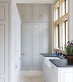 Morning everyone! This is the utility room at the Grange project in Ascot, Berkshire. The Spenlow cabinetry looks stunning and provides masses of storage with floor to ceiling cupboards as well as additional cupboards on the left hand side as well as underneath the sink. Thanks to the huge window it's a lovely light and airy room located just off the main open plan kitchen space | Humphrey Munson