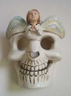 skull mask with angel | an angel on this wooden mask from Mi… | Flickr